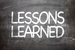 Lessons Learned written on a chalkboard-1