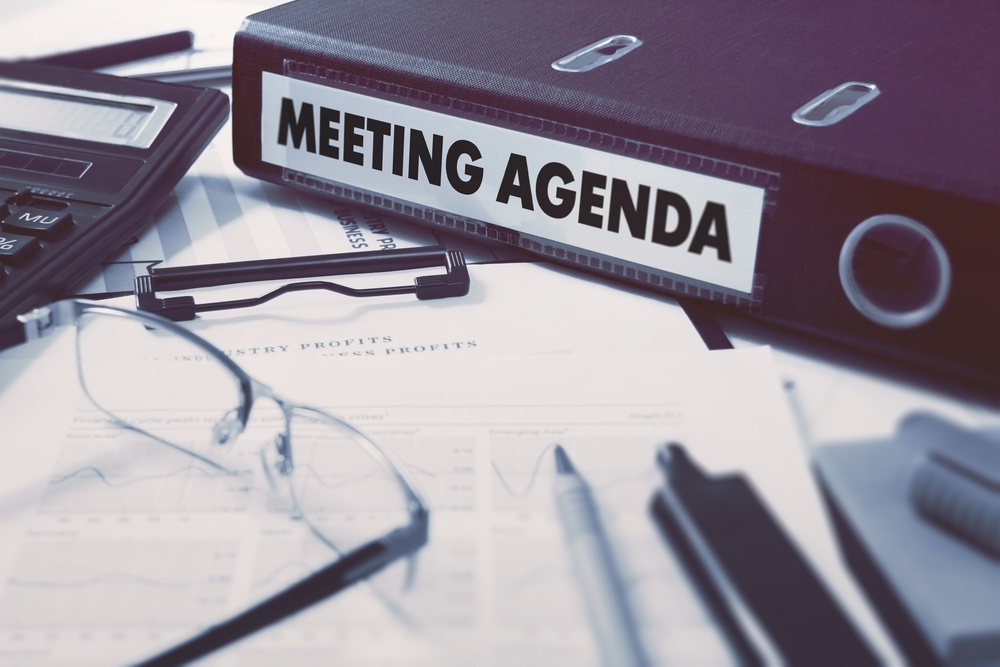 Office folder with inscription Meeting Agenda on Office Desktop with Office Supplies. Business Concept on Blurred Background. Toned Image..jpeg