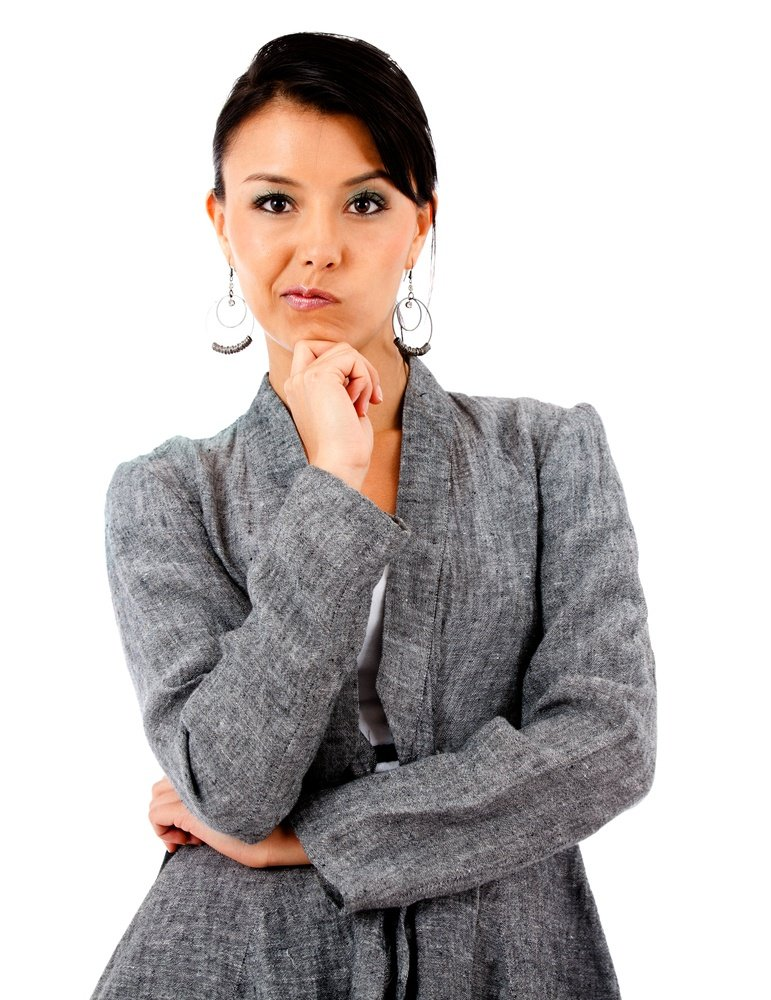 Skeptical business woman - isolated over white