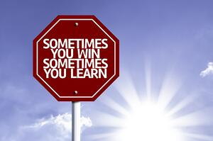 Sometimes you Win Sometimes you Learn written on red road sign with a sky background