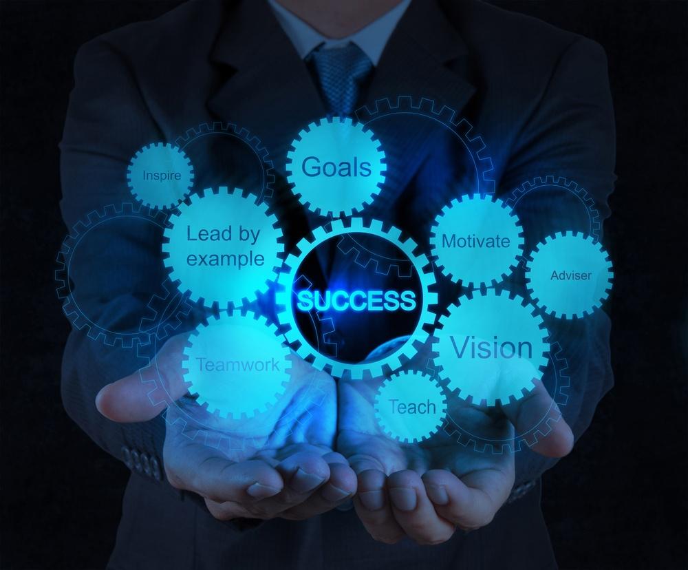 businessman hand shows gear business success chart concept.jpeg