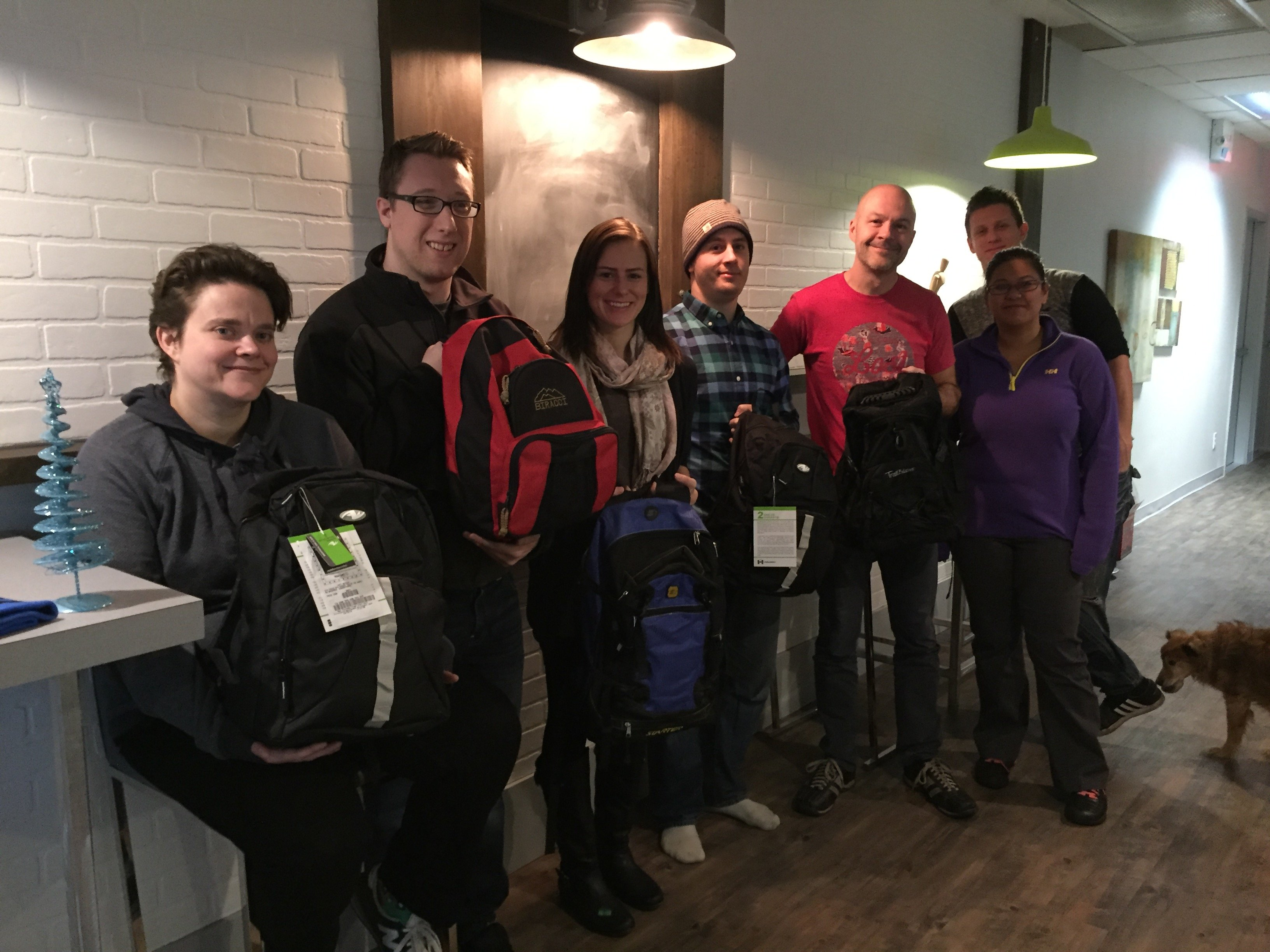 Team with Donated Backpacks.jpg