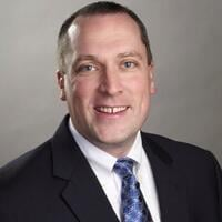 Photo of Jon Reid, CMO of HMC