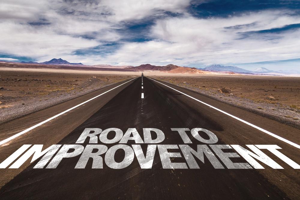 Road to Improvement written on desert road.jpeg
