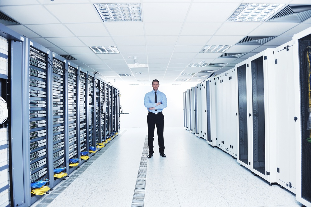 young handsome business man  engeneer in datacenter server room.jpeg