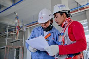construction workers reading document