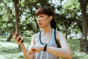 jogger looking at phone and watch