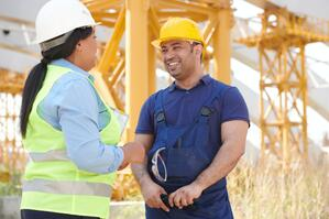 2 construction workers talking