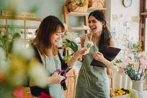 two women in floral shop smiling